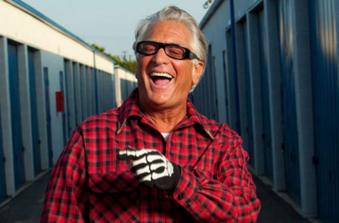 barry weiss showing off his pearly whites and skelton gloves